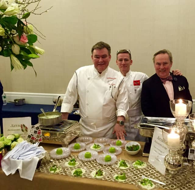 Chef Peter X. Kelly, left, with brothers James, middle, and Ned, right.