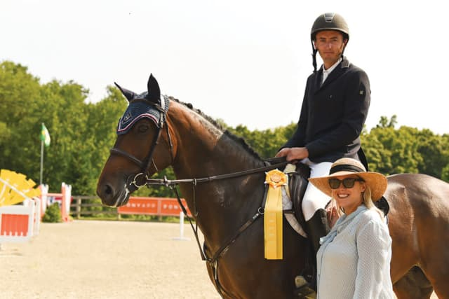 Christian Coyle with wife Chelsea Dwinell, marketing and sales manager for Old Salem Farm, after taking third prize in the Grand Prix of Old Salem Farm's Summer Jumper Classic last year. Photograph by Sarah Latterner.