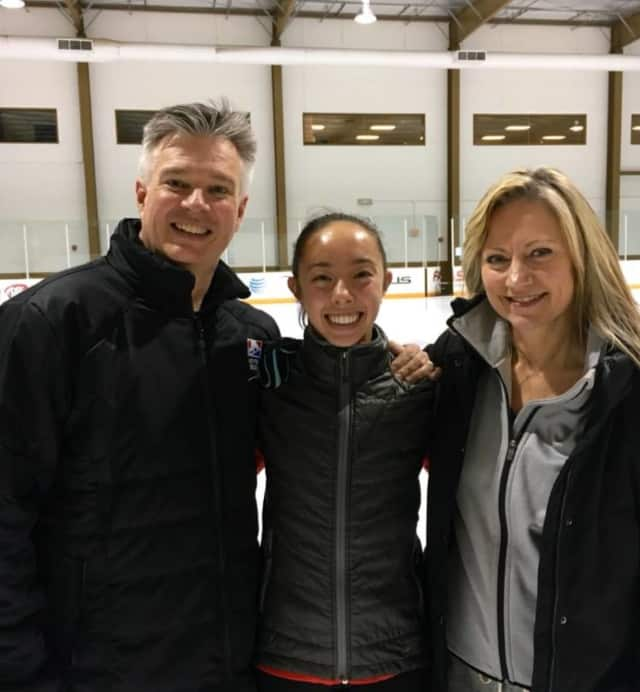 Brooklee Han, center, moved from Redding to train with coaches Peter and Darlene Cain in Texas. Han competes for Australia.