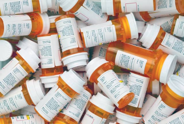 Eight people were arrested for importing mislabeled opioids and then repacking them and selling to customers.