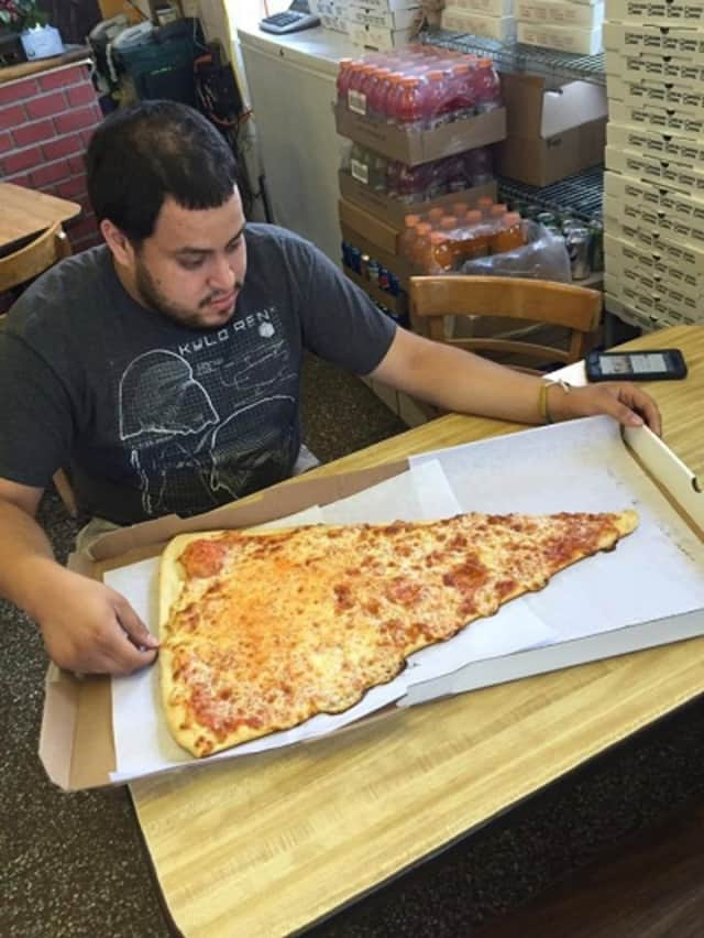 "The 2-foot-long ""super slice"" has 'em flocking to the Pizza Barn in Yonkers."