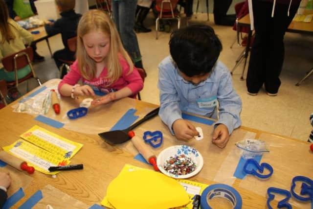 """Pleasantville kindergartners used their math skills to """"visit"""" Main Street."""
