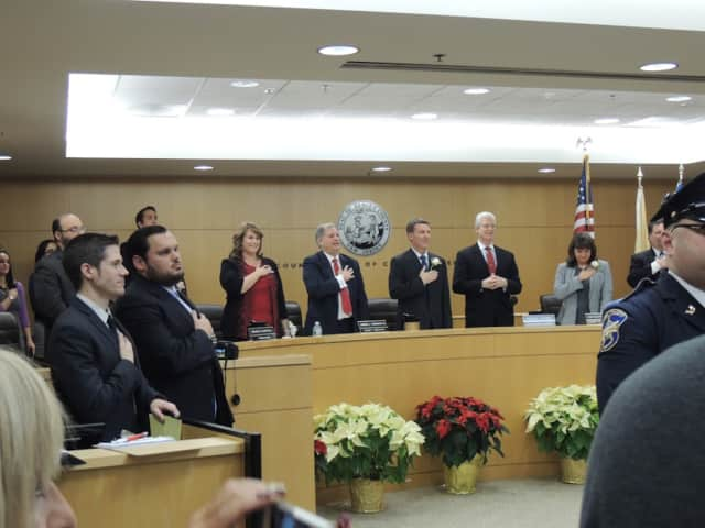 Freeholders give the Pledge of Allegiance to open the reorganization meeting.