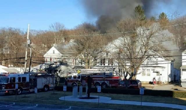 Poughkeepsie firefighters battle a two-alarm blaze that started outside 163 N. Hamilton St. on Monday, Feb. 29, and spread to a neighboring home.