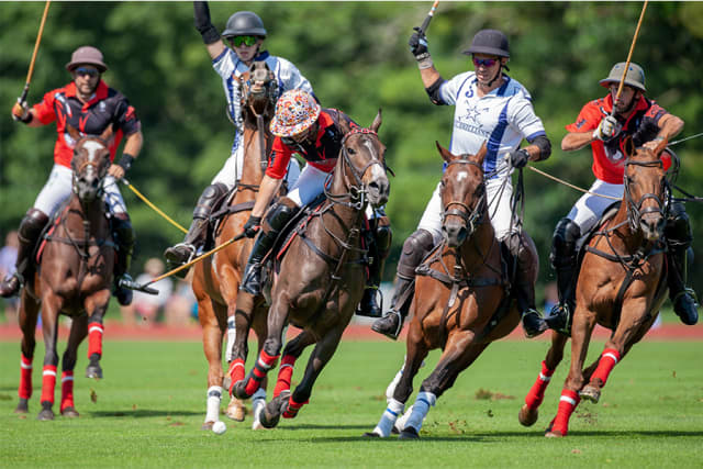 The victorious Postage Stamp team (in red) defeated Mt. Brilliant for the USPA Monty Waterbury Cup June 30 at Greenwich Polo Club.