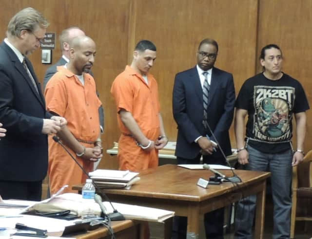 Julio Ponce, Daniel Gomez, John Cando (far right) with their attorneys