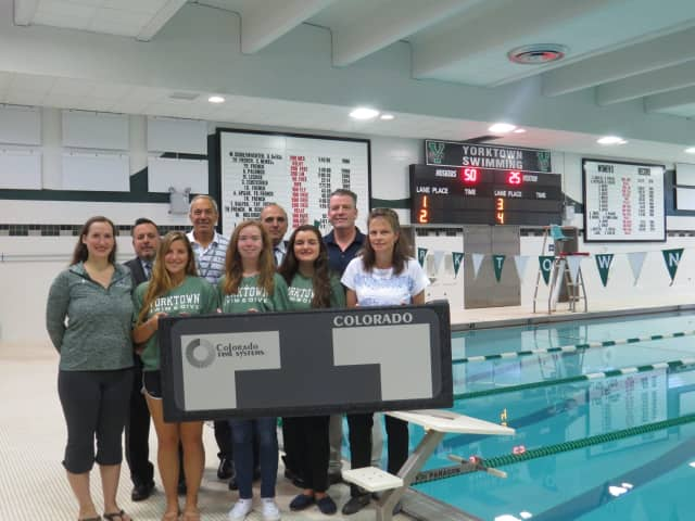 Student swimmers are happy with a new $20,000 scoreboard the swimming pool at Mildred E. Strang Middle School in Yorktown.