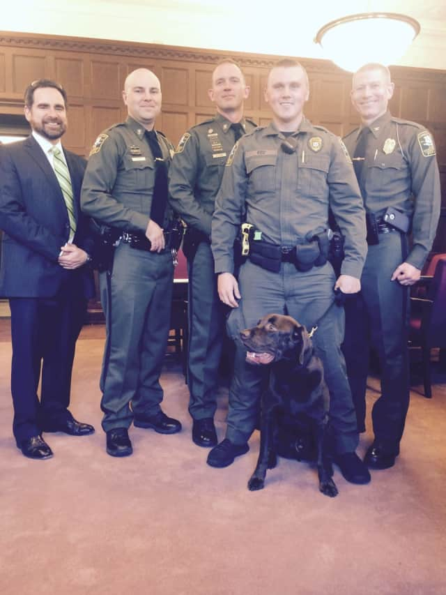 From left, DEEP Commissioner Robert Klee; new Sgts. Greg Ulkus and Matthew Stone; Officer Patrick Kiely and his K9 partner, Baloo; and Col. Kyle Overturf, commander, EnCon Police.