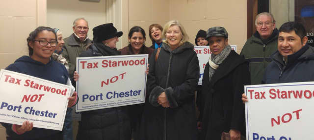 Sustainable Port Chester Alliance members stood in the cold outside the Village Court Building in Port Chester.