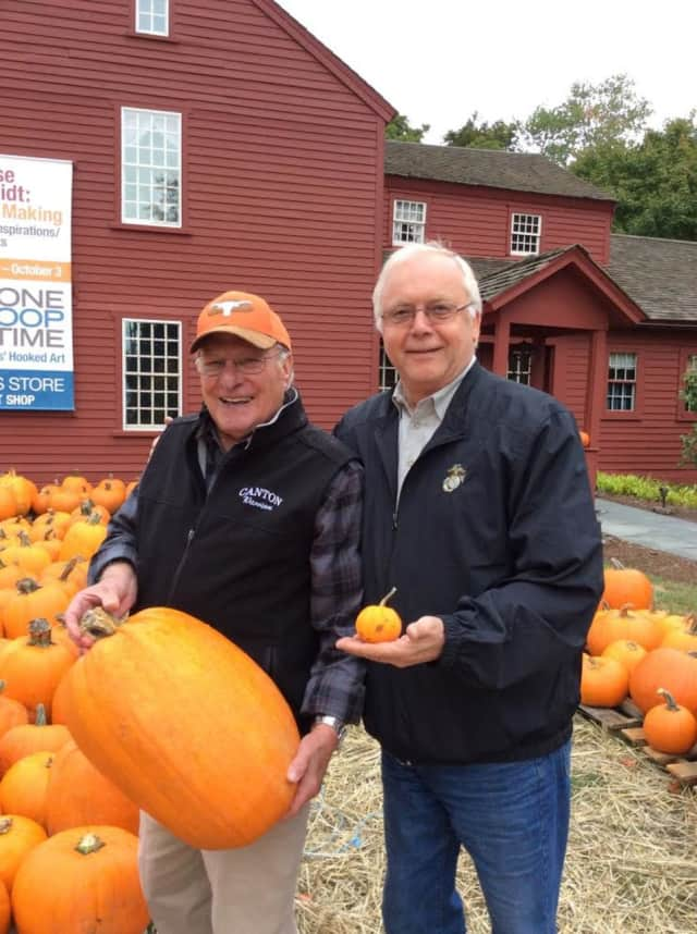 Wilton Kiwanis members Dave Forslund, left, and Raymond Tobiassen show off the range of pumpkin sizes available at the sale.