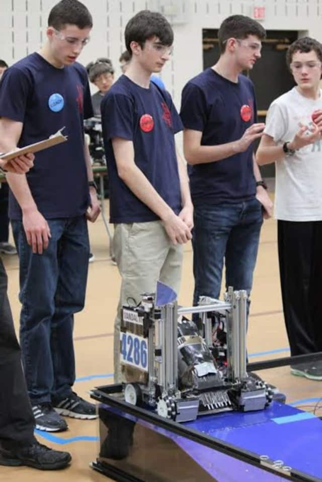 Robots must climb a mountain and complete tasks along the way at this years' qualifying event at Ridgefield Academy.