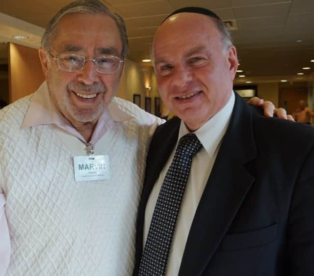 Marvin Eiseman and Rabbi Simon Feld at the annual meeting of the Jewish Home Family.