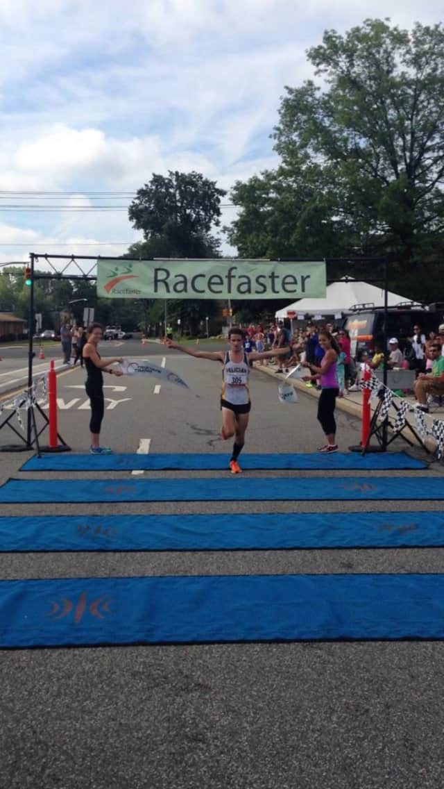 A runner races through the finish line at a recent Racefaster event.
