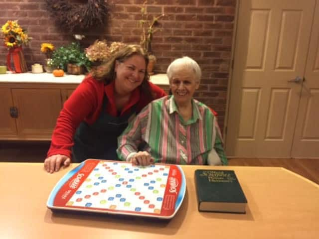 Raimi Jones of Easton volunteers at Waveny LifeCare Network, where she meets Vivian for weekly games of competitive Scrabble.