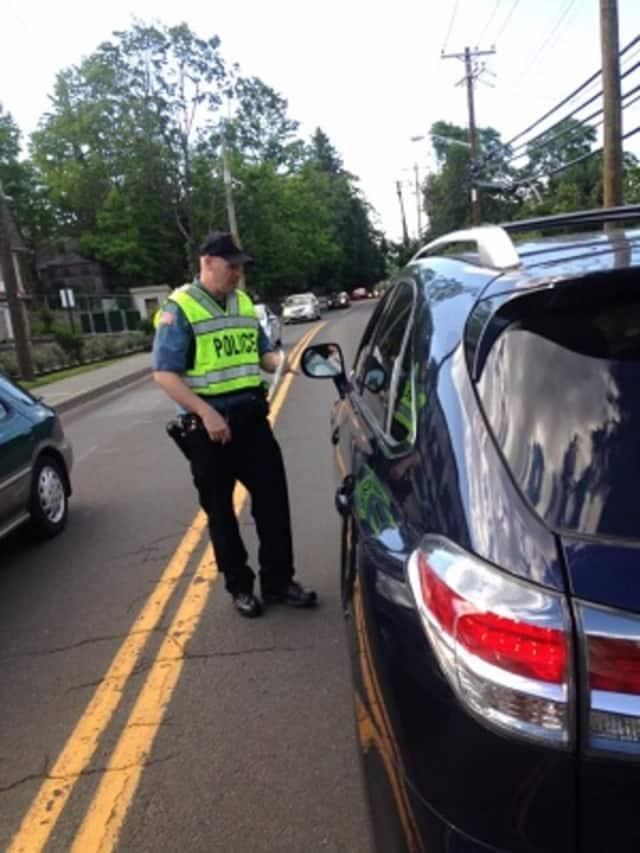 A Ramapo police officer talks to a motorist