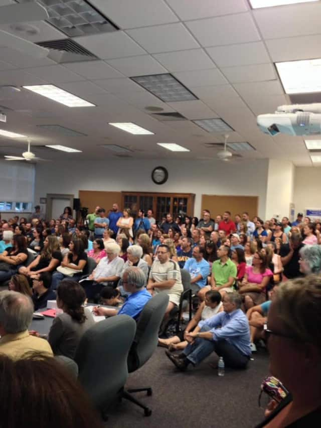 Residents gathered at the Ramapo Central School District's July 12 meeting about a new transportation policy for the next academic year.