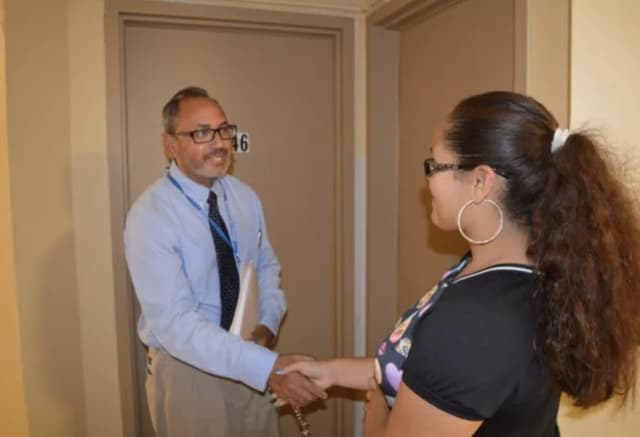 Tomas Ramirez introduces himself to an incoming Bassick High School freshman before the start of the 2016-17 school year. Ramirez will be stepping down at the end of the year, according to the Connecticut Post.