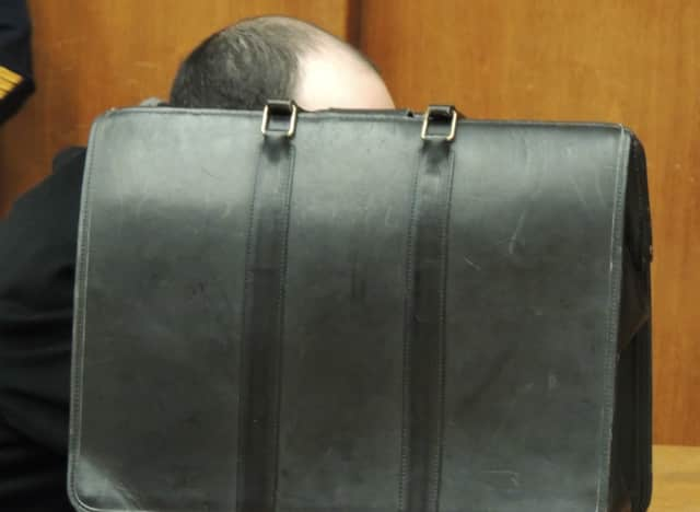 Onn Rapeika remained hidden from a photographer's view during a 2016 court hearing.
