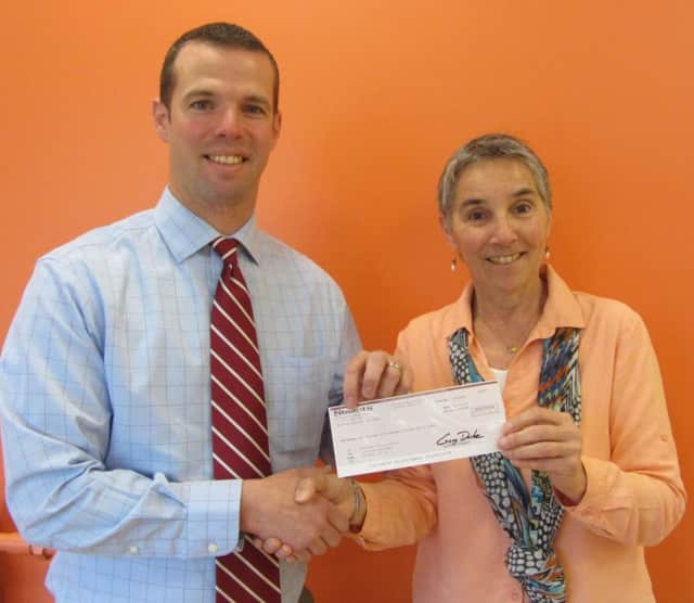 Chris Paine, left, presents check to Maryelisa Blundell.