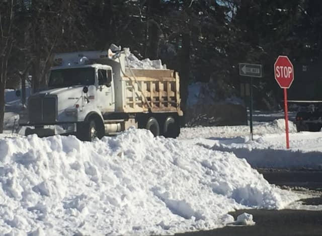 There's just no room to put the snow, so Ridgewood collected it in dump trucks and dropped it at the Graydon Pool parking lot.