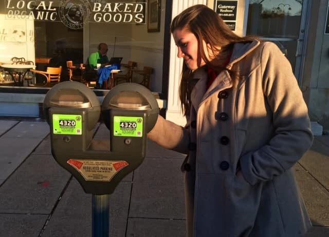 Village visitors can pay the meter with quarters – as seen here – or through the ParkMobile smartphone app