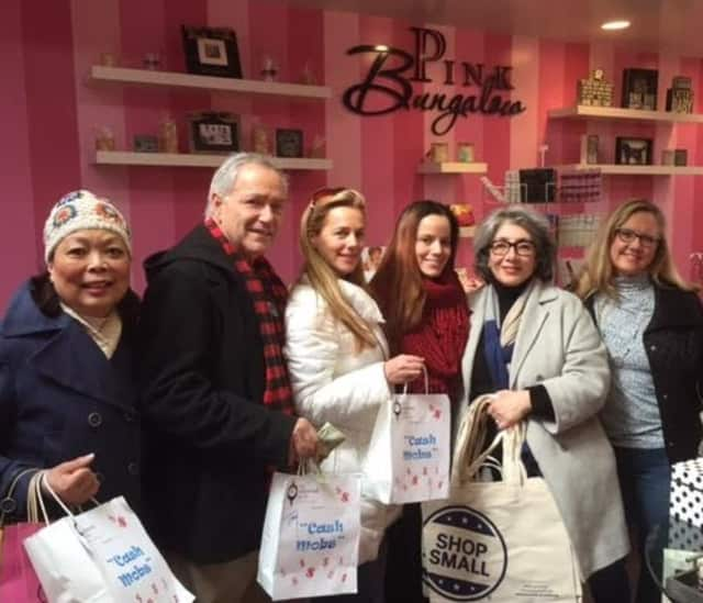 """The Ridgewood Guild's first """"cash mob"""" at the Pink Bungalow, which sells gifts and accessories, cards, paper goods, and jewelry. It also does custom printing."""