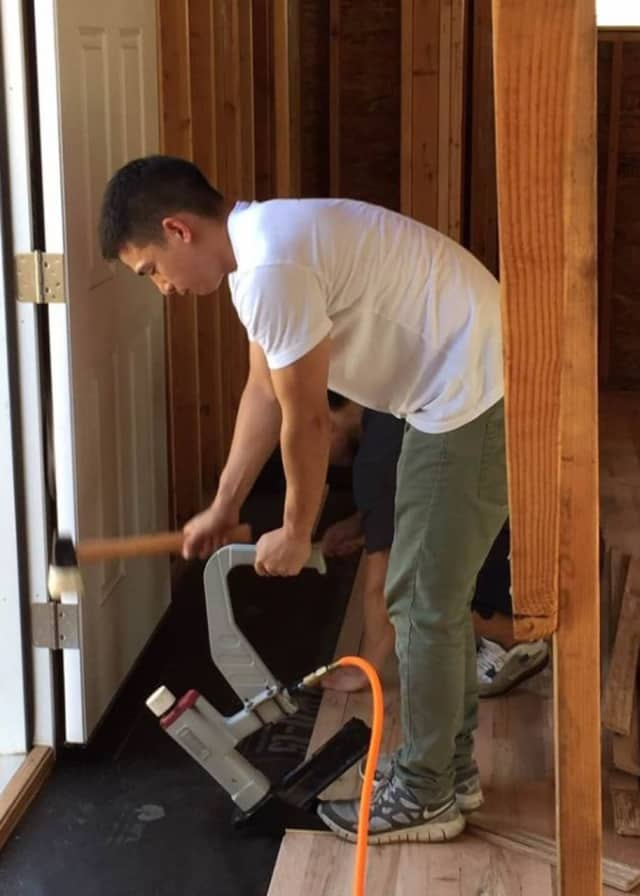 A member of a Habitat crew working on a Bergenfield home.