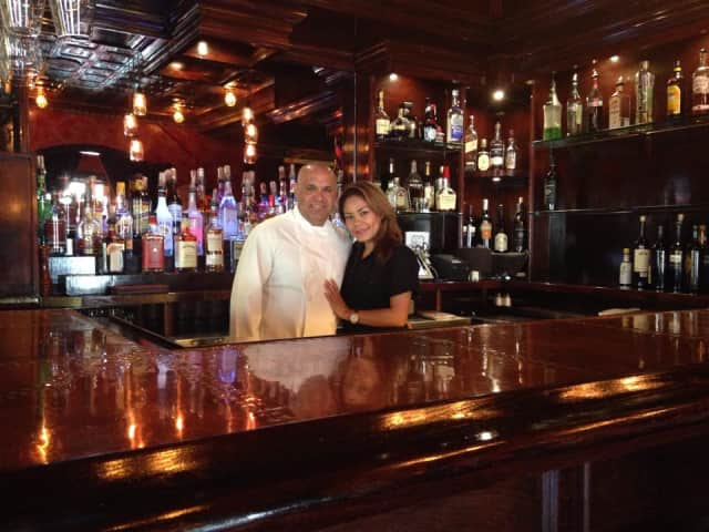 Ben Rivero with his girlfriend and bartender, Natalie Moscoso, behind the bar at Casual Habana's new location in New Milford.