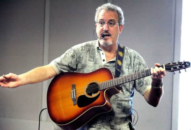Robert the Guitar Guy will bring his special brand of music to the Scarsdale Public Library Tuesday at 10:30 a.m.