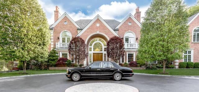 A Rolls-Royce is included in the purchase of a mansion in New Canaan listed by Jennifer Leahy of Douglas Elliman.