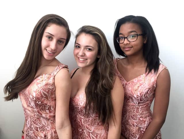 From right to left: Kelly Ainsworth of White Plains as Ronnette, Francesca Ricigliano of Scarsdale as Crystal, and Catherine Serra of White Plains as Chiffon in Little Shop of Horrors at the White Plains Performing Arts Center Conservatory Theatre.