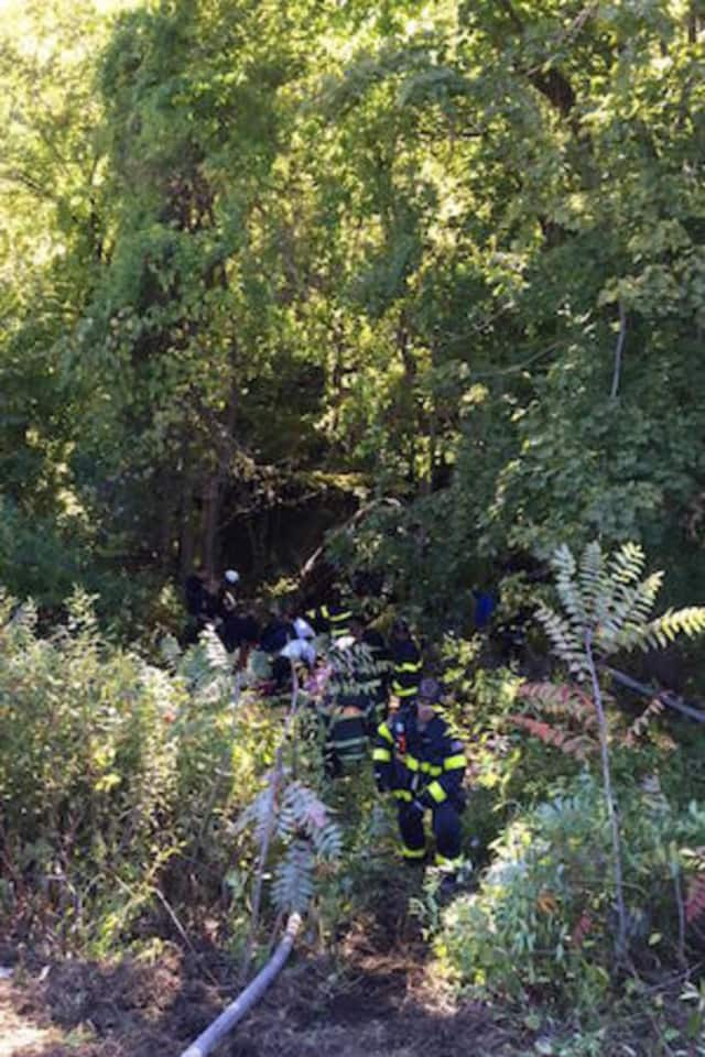Norwalk firefighters and police respond to a rollover accident on Route 7 Tuesday.