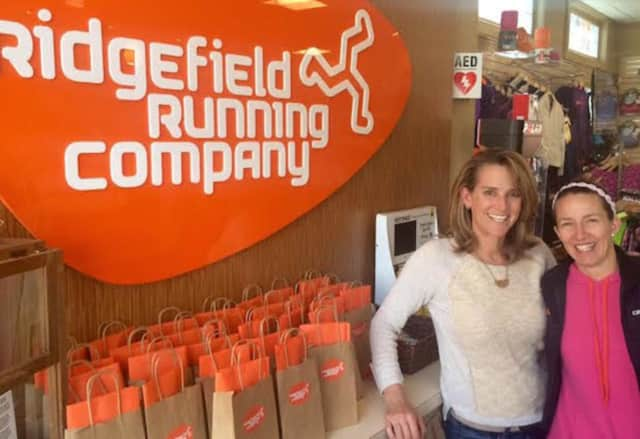 Megan Searfoss, left, and Deb Povinelli are celebrating their first year in business at Ridgefield Running Company.