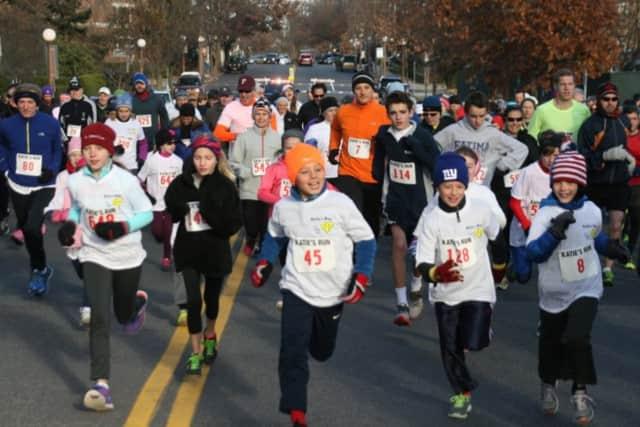 Runners take part in the 2014 Katie Welling Memorial Run/Walk.