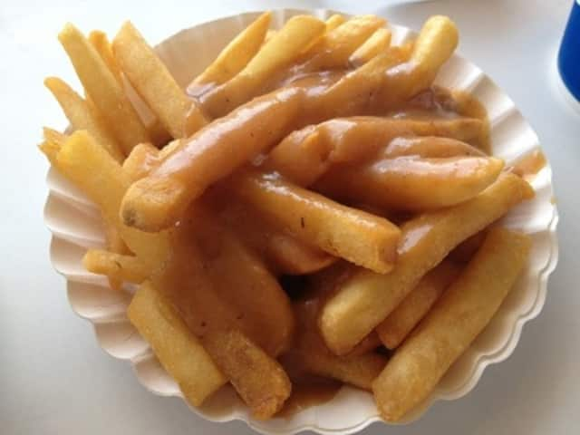 "The gravy-soaked fries at Rutt's Hut in Clifton go good with their famous ""rippers,"" hot dogs deep fried until their casings split and crack."