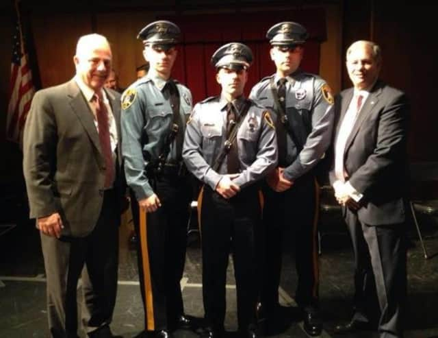 (from left): Saddle Brook Mayor Robert White, Officers Joseph Scrafani, Peter Romero and Timothy Parisi, County Executive Jim Tedesco