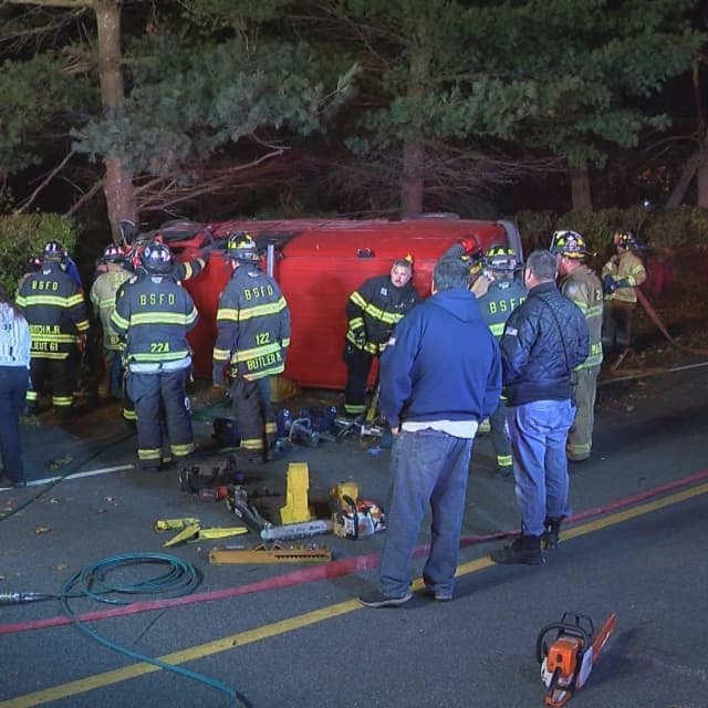 Two people had to be rescued from an overturned van after it slammed into a tree on Long Island.