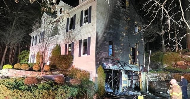 A Stamford home received extensive damage during a two-alarm fire.