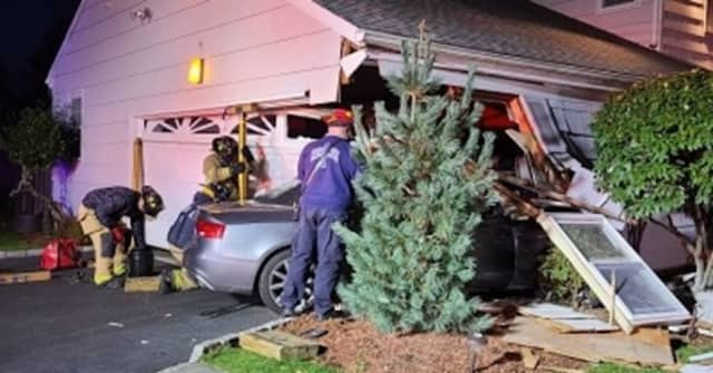 A Stamford home received extensive damage after a vehicle slammed into the garage area.