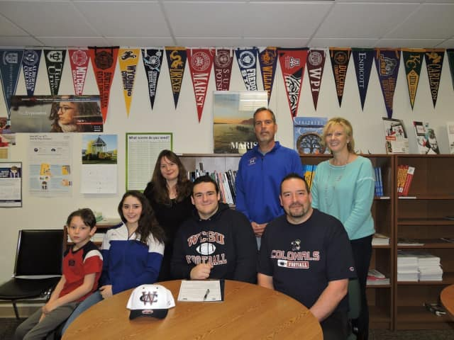 Ryan Sahle signs a letter of intent to play football for Western Connecticut.
