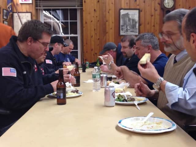 Scarsdale firefighters enjoy a meal at the firehouse.