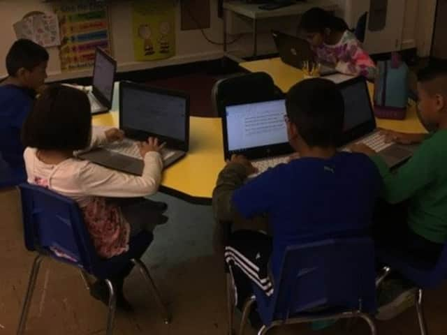 Students at Berkeley Avenue Elementary School in Westwood work on writing essays.