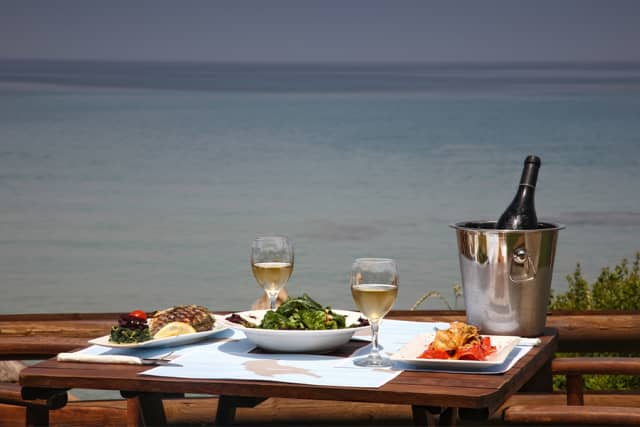 Lunch set for two by the sea.