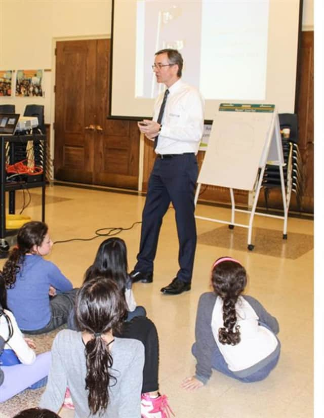 Captain Ian T. Blackley entertained Edgewood fourth-graders with drawings and photos of the inside of historic and modern-day ships during his recent visit.