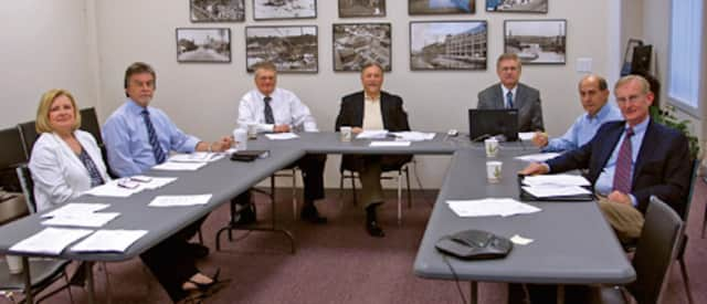 The Shelton Economic Development Corp.'s Executive Committee. James Ryan, at center, is retiring as president in July.