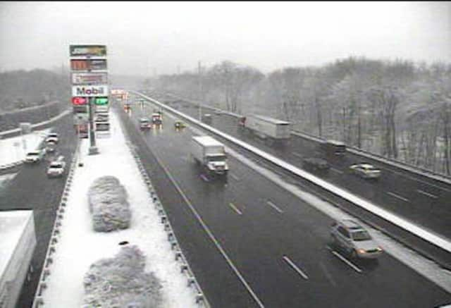 Snow is falling in Darien near the service plaza Friday morning, but traffic is moving along I-95.