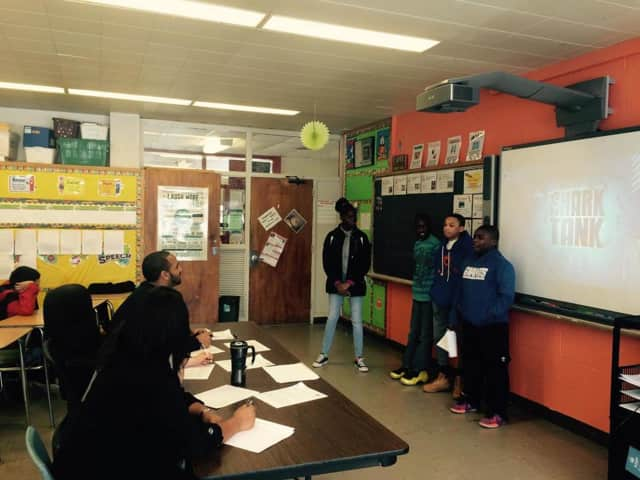 """Woodlands Middle School students try to """"sell"""" their products to a """"Shark Tank"""" panel."""