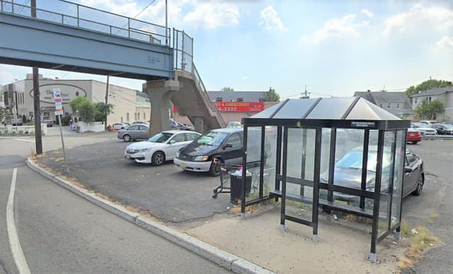 The woman told police she was waiting for a New York City-bound bus in the shelter on the side of the eastbound highway at 6th Street when she was robbed.