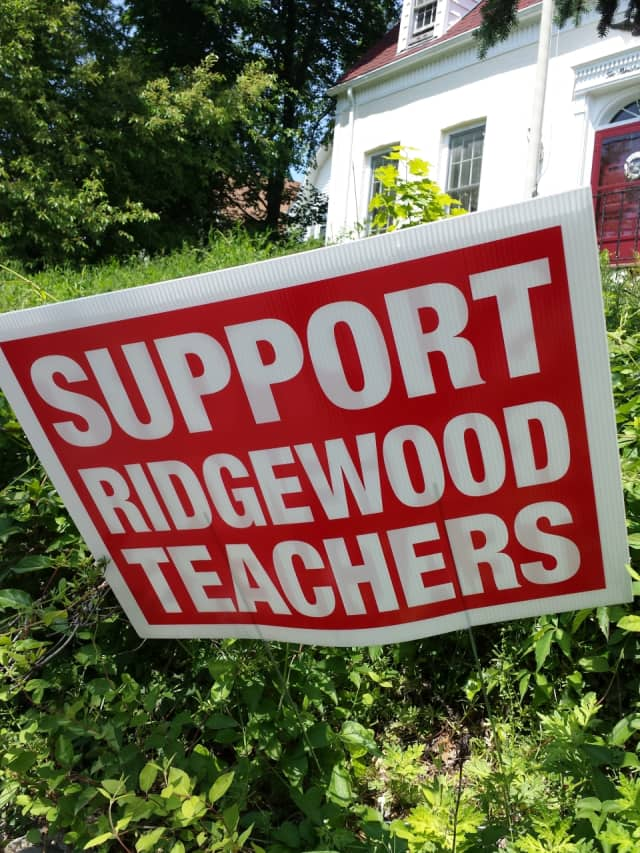 Signs in support of Ridgewood teachers have remained in place all over the village for months.