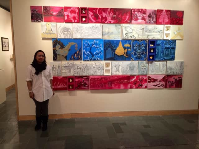 Owner Bee Dellith poses with artwork.